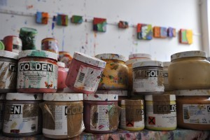 Paint pots in artist Anthony Frost's studio. Photo © Brian Benson, 2016. Image courtesy DACS.